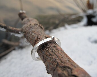 Silver ring with a silver dot
