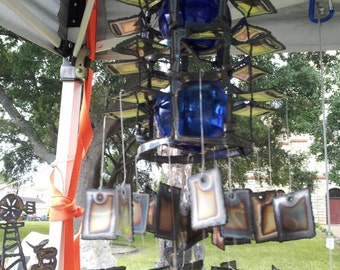 Double glass wind chime with 2 blue 3 inch glass floats and double squares hanging cut from stainless steel