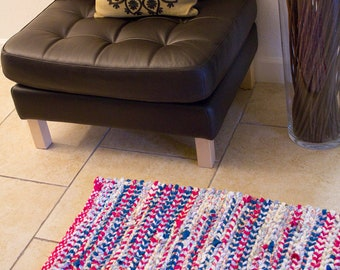 reds and blues with neutrals colorful woven twined rug
