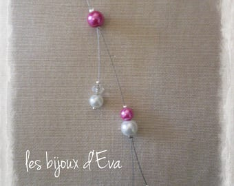 Back of white beads and Fuchsia jewelry