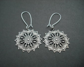 star flower stamped earrings
