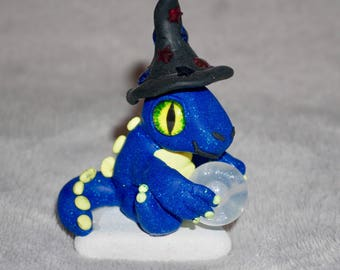 Polymer clay wizard dragon on rock with crystal ball