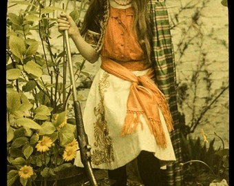 Autochrome Photo of young girl with rifle, early 1900s