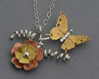 Mixed metal butterfly necklace flower necklace monarch gold butterfly unusual unique sterling silver contemporary jewelry nature necklace
