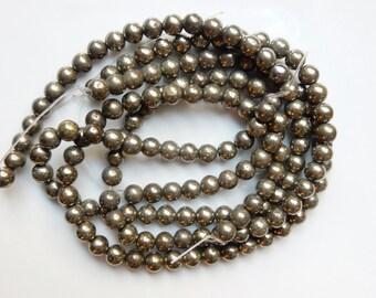 8mm  Pyrite round beads FULL STRAND