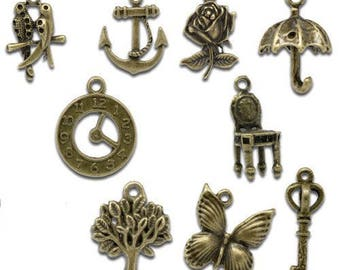 9 brass assortment set Butterfly charm, key, owl, pink