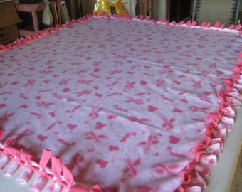 Warm, double sided, hand tied, fleece breast cancer ribbon blanket