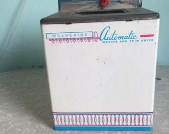 vintage metal toy wash machine from the fifties