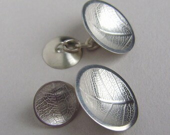 Silver domed leaf texture cufflinks