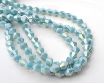 Pale Aqua Luster 6mm Bicone Crystal Beads 12
