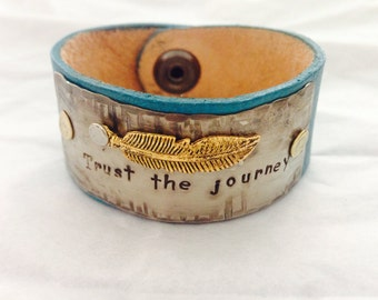 Hand stamped bracelet, leather bracelet cuff , rustic appearance, customize yours today.