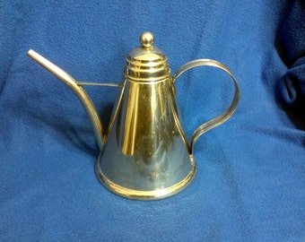 A Silver Plated Pitcher