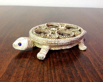 Vintage turtle lipstick holder