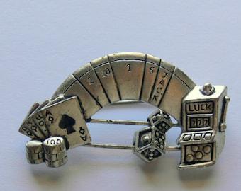 gambler brooch