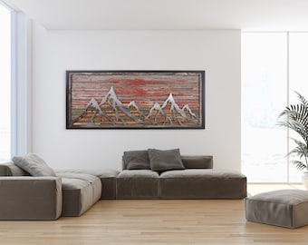 Distressed steel mountain scape with old reclaimed barnwood and fiery red sunset.