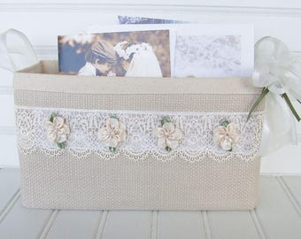 Coastal wedding basket with lace and flowers for cards and photos