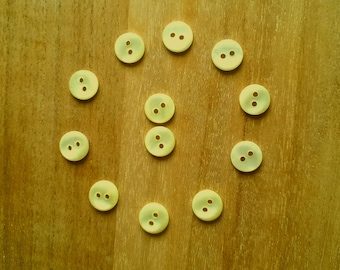 Lot 9 T27 clear yellow buttons