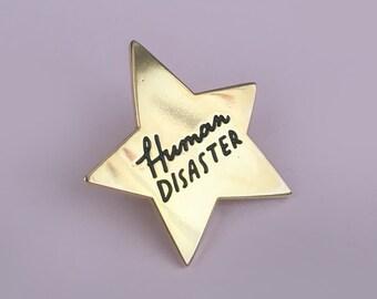 Human Disaster, gold star enamel pin