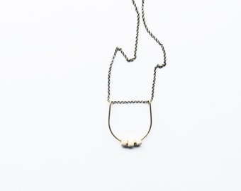 CELIA | Cream Ceramic Mykonos and Brass Beads on Hand-formed Brass Arc Necklace