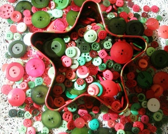 Christmas buttons mix. More than 50 small red and green flat plastic buttons.
