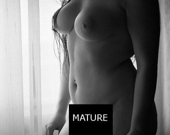 Film photo prints of a nude woman putting on lingerie black and white artistic nude wall art - The Morning Ritual - 07 MATURE