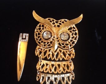 Segmented owl and sword shaped brooches