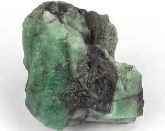 Raw emerald stone of 68 grams with matrix of black mica and quartz.