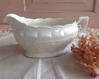 Beautiful old creamy white highly detailed gravy boat
