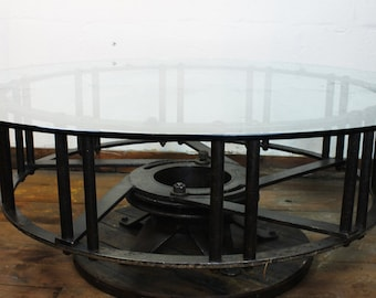 Tractor Wheel Coffee Table With Glass Top, unique table, round table, glass top table, steel and glass table, round coffee table, table