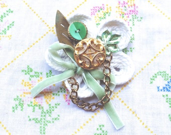 Seafoam Green and Gold Decorated Collage Brooch using Vintage Recycled Jewelry on a White Rope Corded Flower