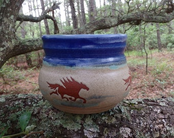 The wild horses of Corolla gallop across this unusual crock