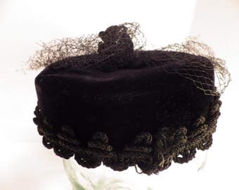 Vintage 1950s 1960s black velvet pillbox Mandarin style hat with topknot and veil by Miss Sally Victor