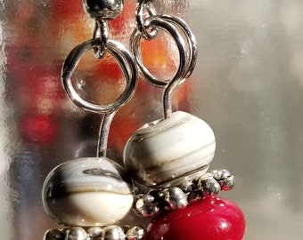 "Lampworked bead earrings with ruby red and off-white ""sediment"" glass"