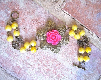 Bright floral bracelet vintage inspired with hot pink and yellow accented with bronze filigree