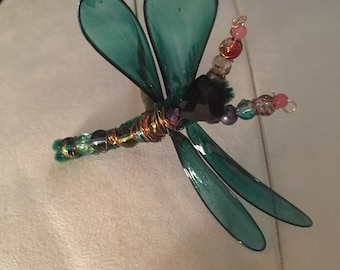 Fantasy film green Dragonfly on stick