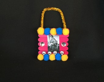 Pink Orange and Blue Frida Kahlo and Diego Rivera Pom Pom Wooden Popsicle Stick Ornament