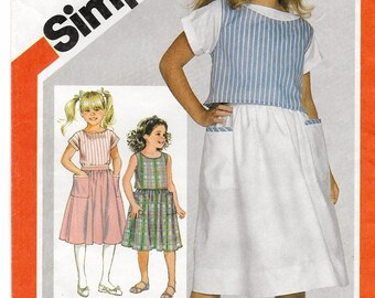 "A Sleeveless Top, Short Sleeve Blouse, and Gathered Skirt Pattern for Girls: Uncut - Sizes 10-12-14, Breast 28-1/2""-32"" • Simplicity 6304"