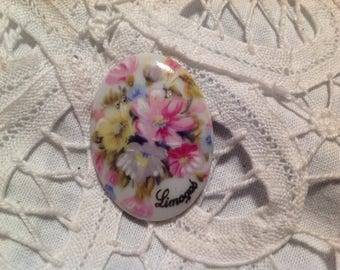 Vintage porcelain cabochon has bouquet decor