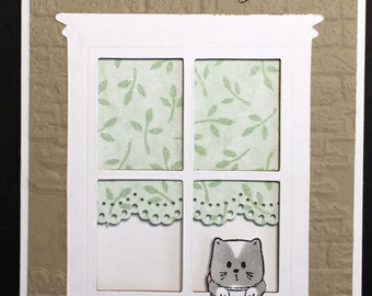 Kitten or puppy at window card
