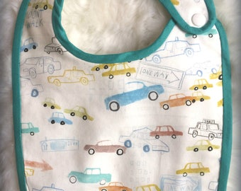 cotton printed patterns taxis and white Terry bib.