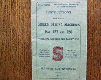 An original Singer Sewing manual. For Singer Sewing Machine numbers 127 and 128.  Dated 1925.