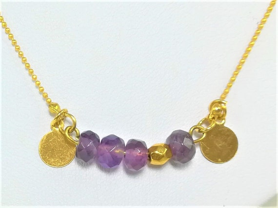 feminine necklace with gold plated medals, extrafine chain and faceted amethyst
