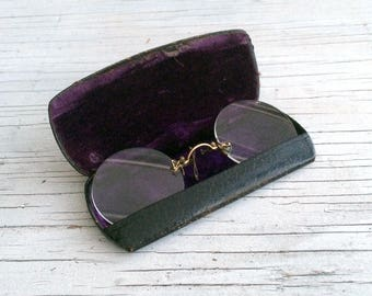 Antique glasses from Theodore Hamblin, Wigmore Street, London. Collectable spectacles, circa 1920s.