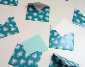 Set of small blue envelopes with hearts