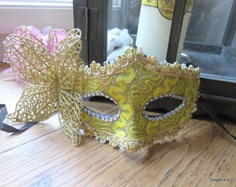 yellow and gold Venetian Wolf mask in lace