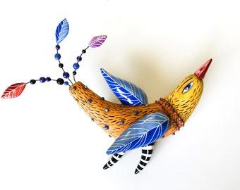 Orange Bird With Blue  Whings