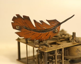 steampunk leather hair clip , feather (made to order)