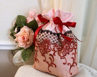 pink pouch, embroidered tulle, black fishnet, red embroidery