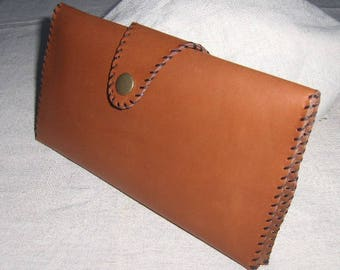 Hand stitched light brown leather pouch