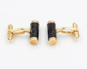 Elegant goldtone bar cufflinks with faux black leather
